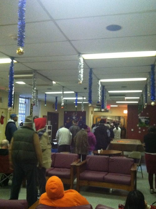 Belle Harbor Manor residents line up to receive their monthly allowance despite allegations that they are paying rent while living in shelter on the campus of a psychiatric facility in Queens. Photo: Kristine Rakowsky